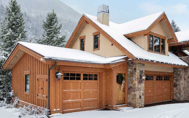 A snow capped wooden cabin in Vail.