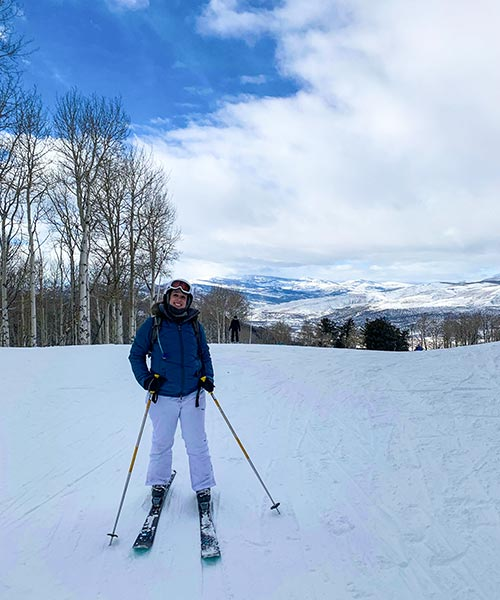 Woman standing in her skis on a ski slope in Beaver Creek.